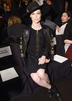 At the Herve Leger by Max Azria show, model Coco Rocha sat front row in a head-to-toe black ensemble. Gold embroidery and a look-at-me hat made her front row appearance all the more memorable.