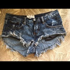 One Teaspoon Shorts One Teaspoon Bonitas cut off shorts. Low waist, medium rise, button fly, raw cuff hemline. Size 24 One Teaspoon Shorts Jean Shorts