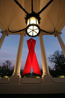 A red ribbon adorns the North Portico of the White House Friday, Nov. in recognition of World AIDS Day and the commitment by President George W. Bush and his administration to fighting and preventing HIV/AIDS in America. White House photo by Eric Draper
