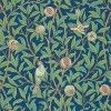 One of the last of the true Morris designs from 1926, showing birds amongst branches of foliage and pomegranate fruit. Shown in the green and deep blue colourway.  Please request sample for true colour match.