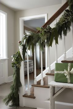 1000 images about christmas garland swags and banners on for Hanging garland on staircase