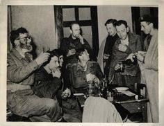 1944- Some of the lucky 2000 survivors of the 9-dat battle at Arnhem enjoy their first drink at Nijmegen, Holland, after their evacuation from the Nazi trap.