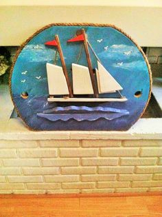 Folk Art Sailing Ship Art Piece.  I made this piece from the top of a wood spool I had.  I painted on the scene, then cut out the boat pieces, painted, then trimmed with rope. $59   Thanks for lookin' :)