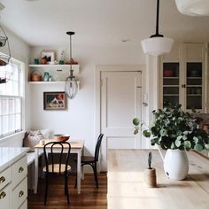 NIce use of space for the breakfast table in his very pretty kitchen