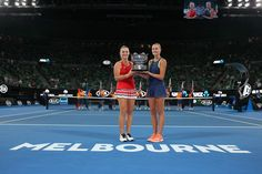 Timea Babos (L) of Hungary and Kristina Mladenovic of France pose for a photo with the championship trophy after winning the women's doubles final against Ekaterina Makarova of Russia and Elena Vesnina of Russia on day 12 of the 2018 Australian Open at Melbourne Park on January 26, 2018 in Melbourne, Australia.