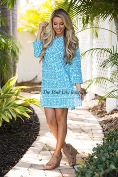 Imagine yourself walking on the beach in this super cute dress! It features a gorgeous greek key style pattern in aqua and white for a stunning pattern. It's easy to wear in multiple ways - you can rock it as a swimsuit cover up with sandals or wear it as a standalone dress with wedges!