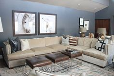 Grey walls, beige velvet sectional, trio of brown leather ottomans.... Throw pillows to pull it all together