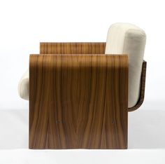 Two-seat sofa in imbuia wood with bone colored leather upholstery. Created for the SESC hotel, 1990. Designed by Oscar Niemeyer, Brazil.