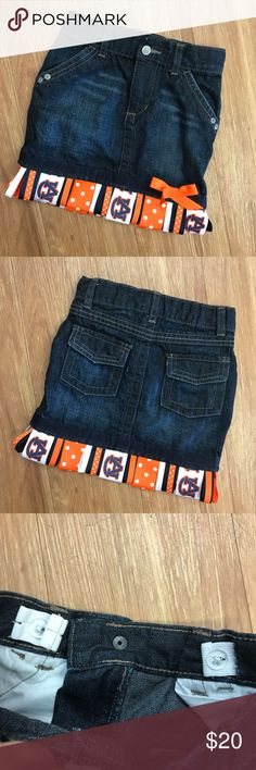 AUBURN TIGERS Embellished Denim Skirt  Old Navy 4T AUBURN TIGERS Embellished Denim Skirt  Old Navy 4T  Super cute Old Navy skirt size 4T.  Has been embellished with Auburn Tigers ribbon.  Very good to excellent used condition.  Adjustable waist. Old Navy Bottoms Skirts