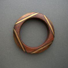 Vintage Bracelet   Designer unknown.  Wood inlaid with brass and dark wood.