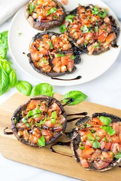This Portobello Mushroom Bruschetta is my new spin on a classic with tomatoes, basil, and garlic. 5 ingredients, 2 easy steps, vegan, gluten free appetizer.