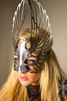 I like this mask because it covers the face disguising the features, however it isn't a solid mask it has shapes cut out of it to to create the intricate and delicate design.