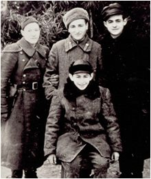 Yitzak Sonenson pictured in front with three other Jewish partisans with whom he lived with in the fall of 1944.