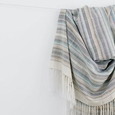 This striped throw blanket is handwoven by artisans in Peru using 100% luxe baby alpaca, all made start-to-finish in a fair trade environment.