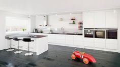 Low cabinets on one side - the oter wall covered floor-to ceiling with cabinets & appliances