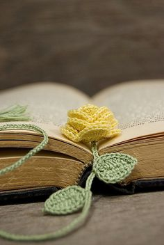 Crocheted Yellow Rose Bookmark--just a picture here, but this would be an easy hack--Size 10 crochet cotton, find a flower pattern and a leaf pattern (I've pinned a few), chain a stem--viola!