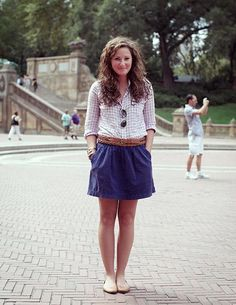 Gives me hope that curly hair can look intentional. Love the gingham. Love the shades. Love the cut and color of skirt (wish it were longer). Like the doubled belt.