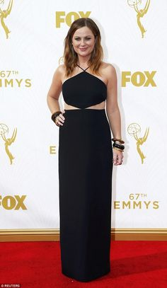Oh Amy! Ms Poehler showed off a trim midsection in this cut-out dress with a halter top...