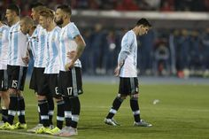 Argentina's Lionel Messi, right, reacts after Argentina's Gonzalo Higuain missed his penalty kick against Chile during the Copa America final soccer match at the National Stadium in Santiago, Chile, 4.7.15