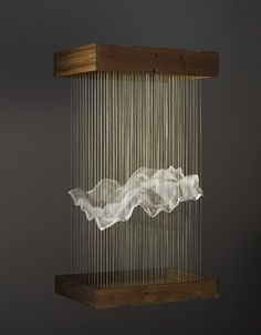 MAGGIE CASEY: Hanging Cloud, thread, silk organza, copper tacks, wood, 2006. Casey creates mathematical structures informed by her education in weaving. She refers to these structures as 'hanging tapestries' . I love the landscape like quality of the silk organza.