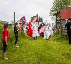 All across America, Klan and neo-Nazi groups are not only flourishing—they're joining forces.