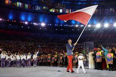 flag-bearer-karol-bielecki-of-poland-leads-the-team-entering-the-picture-id586316774 (594×399)