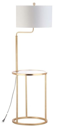 Inspired by the newly renovated lounge in Manhattan's grandest hotel, this floor lamp side table is ideal for the modern living room. Imbued with sty