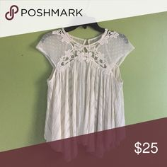 Free people swing top Never worn Free People top with lace and muslin. NWOT. Beautiful detail and cream sheer fabric. Free People Tops Blouses