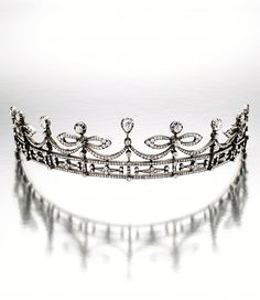 DIAMOND TIARA, LATE 19TH CENTURY Of ribbon bow design, set with old mine-cut and pear-shaped diamonds together weighing approximately 14.00 carats, mounted in silver-topped gold, inner circumference approximately 255mm, one tiny diamond deficient.