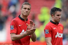 Nemanja Vidic applauds the Old Trafford crowd for the final time after United beat Sunderland in May 2014
