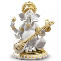 A tribute to the Hindu god, the Lladro Veena Ganesha Golden Re-Deco figurine glows with intricate gold-tone detailing accenting rich porcelain. Lord Ganesha, Ganesha Art, Lord Shiva, Women's World Cup, Mens Gift Sets, Baby Clothes Shops, Baby Shop, Porcelain, Sculpture