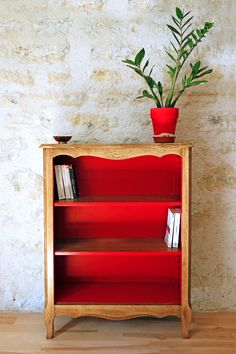 old bookcase with bold painted interior