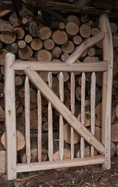 A cleft chestnut pedestrian reversable gate, faced on two sides, the whole frame constructed using mortise and tenon joints pegged with oak draw-pins, with mortised pales.