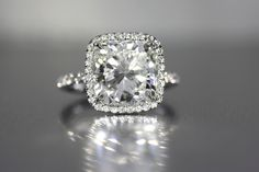 Cushion shaped diamonds in halo style settings.