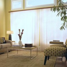 Have a large window but hate traditional vertical blinds?  Vertical sheer shades are part blind and part curtain - soft, functional and beautiful!