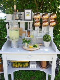 DIY Farmhouse Outdoor Bar or Potting Bench - using an old table and pallet, I created this functional and fun drinks bar in a farmhouse style! #diy #bar #outdoorbar #pottingbench #farmhouse #farmhousedecor #farmhousestyle #gardentable #patiodecor #summerparty