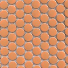 moddotz porcelain penny round tile mango orange.  this is a neat color option with a gray grout?