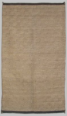 A Navajo two faced diamond twill double saddle blanket woven in all handspun natural wool in ivory, dark brown, and hand carded grey.