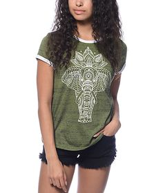 Pay tribute to the gorgeous giant creature of the dessert, the elephant. This Toby Ethno Elephant olive ringer t-shirt by Trillium has a soft nubby material with flecks of navy running throughout while the embellished elephant decorates the front of this