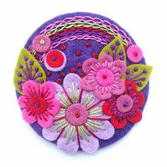 pretty designs w/ embroidery on felt.