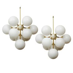 Pair of Spectacular Sputnik Fixtures in the Style of Stilnovo | From a unique collection of antique and modern chandeliers and pendants  at https://www.1stdibs.com/furniture/lighting/chandeliers-pendant-lights/