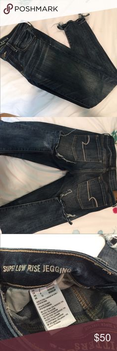 NWOT AE super low rise jeggings NWOT super low rise AE jeans with the frayed bottoms Very stretchy and great fit. Unfortunately I bought them without trying on and took the tag off. American Eagle Outfitters Pants Skinny