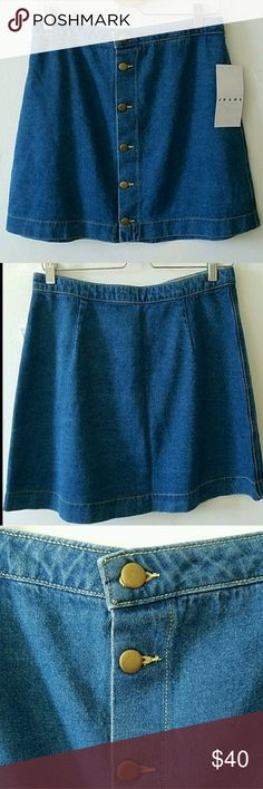 American Apparel High Waisted Denim Skirt This skirt is high waisted with six buttons. It is brand new wirh tags and was originally $62. This is an AA size Medium. American Apparel Skirts Mini