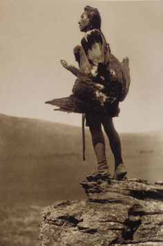Eagle Catcher  This man is thought to be Sioux, probably from Northwestern Nebraska.  This is a posed shot.  Full-sized eagles were not caught by hand, but in baited pits.  Eagle feathers had special ceremonial significance to the Plains tribes.  Photographed in 1907 by Edward S. Curtis