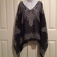Black and White Paisley Cold Shoulder Poncho Cold Shoulder Ponchos are the hot trend for vacations and summer style! Black and white paisley print with tie at back of neck for better fit. 100% polyester. Size S but generous. Tops