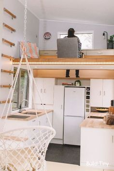 This is an interesting solution to the problem of getting enough room for a proper work desk.