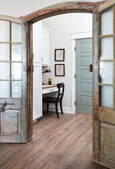 We tucked the home office behind these beautiful antique french doors off the kitchen. It's a perfect little nook to steal away and get a few things done without distractions.