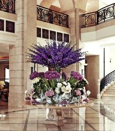 Now that is my kind of floral arrangement! Petals in every shade of purple provide a royal welcome to Four Seasons Hotel Amman. Deco Floral, Arte Floral, Floral Design, Purple Wedding, Wedding Flowers, Wedding Bouquets, Hotel Flower Arrangements, Flower Decorations, Wedding Decorations
