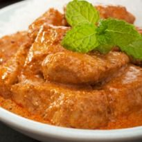 Cubes of Soft Cottage Cheese Cooked in a Luscious Tomato & Cream Gravy.   It's Easy, it's Creative and it's Just Bang-On!