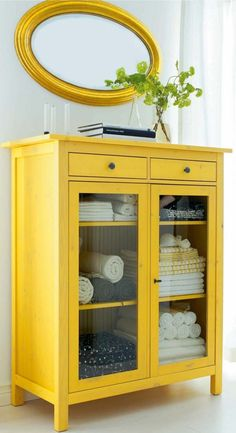 IKEA furniture showcase wood beach towels, yellow painting